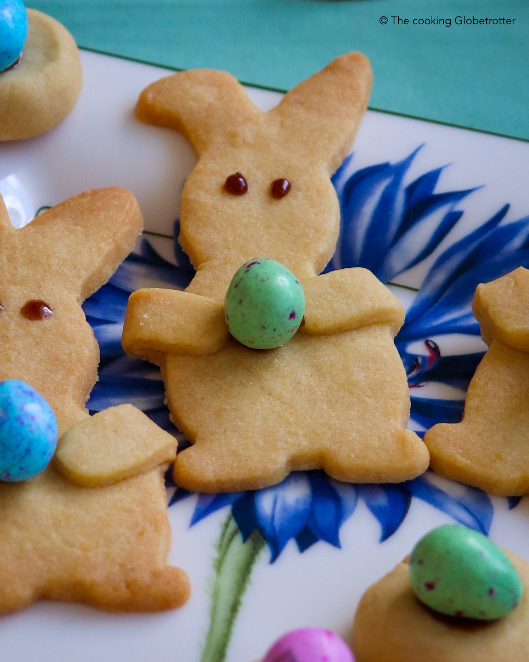 Bunnies cookies holding chocolate eggs