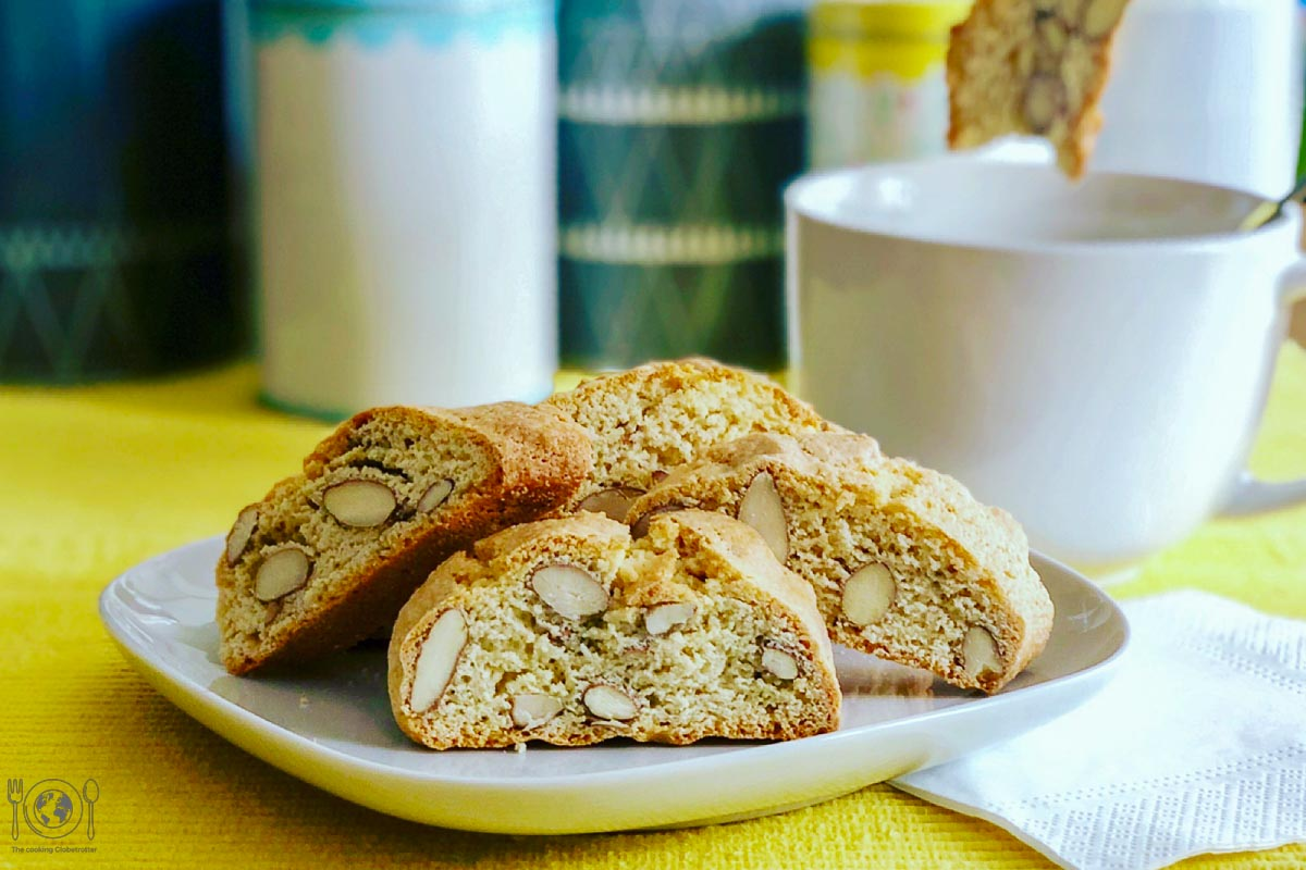 Cantucci are dairy free Italian biscotti filled with almonds and ideal to dip in your coffee, tee or wine! Yes, wine! Find out why...